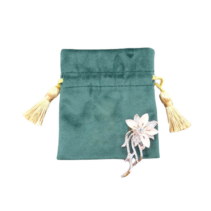 suede pouch with tassel